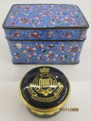 Eastern enamel box and cover with allover pink flowerhead decoration on a blue ground,