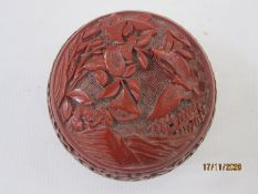 Chinese cinnabar lacquer box, circular and lidded, decorated with columbine and butterfly, 9cm