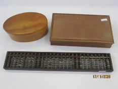Oval bentwood box and cover, an abacus and one other box (3)