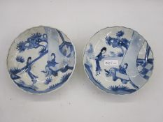 Pair Chinese porcelain saucers with two figures in a garden, six-character mark for Cheng-Hua to