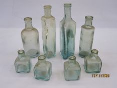 Collection of eight chemist and ink glass bottles including one from Osmond & Son Ltd, Grimsby