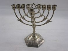 Silver menorah with import marks for Israel Freeman & Son Ltd, London 1960, of typical form, on a