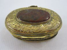19th century oval gilt metal and onyx trinket box, the oval engraved lid mounted with central oval