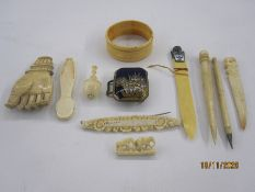 Quantity of antique ivory miniatures to include back scratcher hand, miniature paper knife with