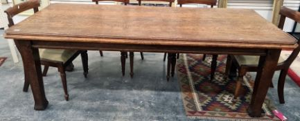 Late 19th/early 20th century oak dining table, the rectangular top with canted corners, moulded
