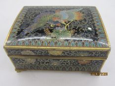 Cloisonne box, rectangular with slightly domed hinged lid, decorated with a phoenix within lappet