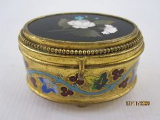 Late 19th century Italian gilt metal jewellery box of oval form, the hinged cover inset with a