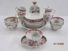 Late 18th century Chinese export porcelain part tea service with pink scale borders and floral spray