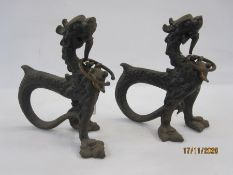 Pair 19th century Asian cast metal model dragons with curved tails, 24cm high (2)
