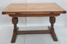 Early 20th century rectangular oak extending dining tablewith cleated end supports to the top,