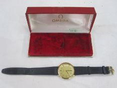Gentleman's Omega De Ville strap watch, the circular dial with baton markers in gilt metal case with
