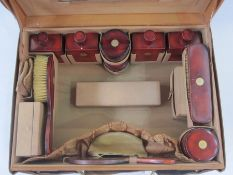 Circa 1930's leather vanity case opening to a leather interior, enclosing red lacquer and inlaid