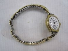 Lady's 9ct gold Hirco bracelet watch, the circular dial with subsidiary seconds dial and on