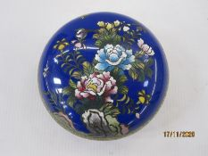 Cloisonne enamel circular bowl and cover, blue ground and decorated with flowers and butterflies,