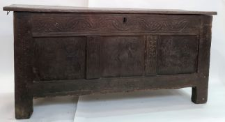 Late 18th/early 19th century oak coffer, the plain top above carved front panels, on stile supports