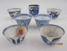 Two pairs of underglaze blue Chinese porcelain miniature tea bowls, two others and a porcelain