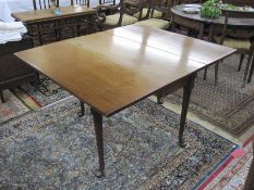 Antique mahogany drop-leaf rectangular dining table, on turned support and pad feet