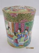 Chinese Canton porcelain tea caddy and cover, cylindrical and painted with figures in a garden, in