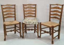Set of four ash and elm ladderback dining chairswith rush seats