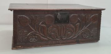 17th century oak bible box, the plain rectangular top, the carved front with tulips and other