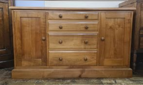 Modern cabinet/chest with four short drawers flanked by pair cupboards, 130cm wide