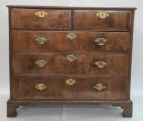 Georgian-style walnutwood chest of two short and three long graduated drawers with brass swan-neck