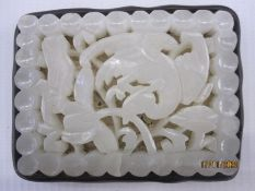 Chinese pale celadon carved jade openwork plaque, Ming dynasty, rectangular and carved with a wild