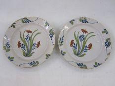 Pair of Delft plates, floral decorated, 22.5cm diameter (2)