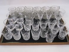 Five Waterford cut glass  pedestal tumblers, collection of cut wines, tumblers and pressed mugs