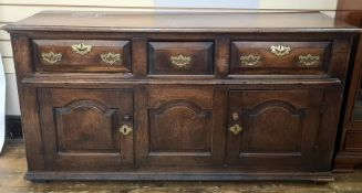 Antique oak sideboardhaving quadrant mould edge, three frieze drawers each with chamfered edge,