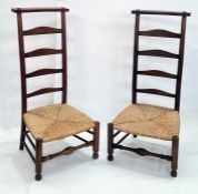Pair of 20th century rush seated ladderback country prie-dieu chairswith low seats, on turned