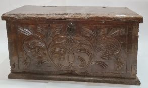 Antique carved oak coffer, the front panel with foliate scroll and all on plinth base, 91cm wide (