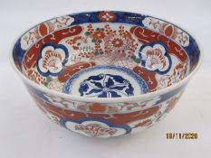 Japanese Imari porcelain bowl with decoration in typical colours of fans in shaped panels amid