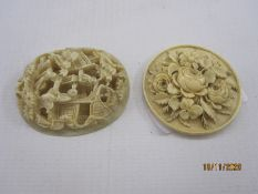 Two Chinese carved ivory miniature plaques, an oval example with figures beside wooded pavilions,