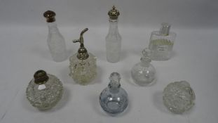 Collection of glass bottles, including silver topped example (Thomas Bradbury and sons,