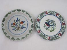 Delft plate, floral decorated with green rim, 22cms diam and a modern Delft plate with bird to
