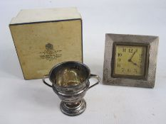 A 1920s silver mounted square framed alarm clock, Arabic numerals to the dial, engine turned