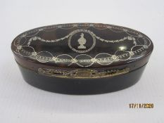George III tortoiseshell box of oval form, the hinged cover with silver pique work, wirework