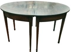 19th century mahogany oval dining tablein two halves, on square section tapering supports to
