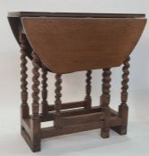 Antique oak gateleg dining table, oval, having single end drawer, on barleytwist turned supports