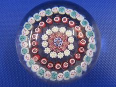 Baccarat paperweight, millefiori decorated with five rings of coloured canes, 6.5cm diameter, with