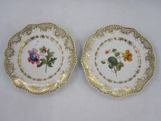 Pair Chamberlains Worcester dessert plates, floral painted and gilt bordered (2)