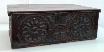 Possibly 16th century oak bible box, the plain rectangular top with carved front featuring two