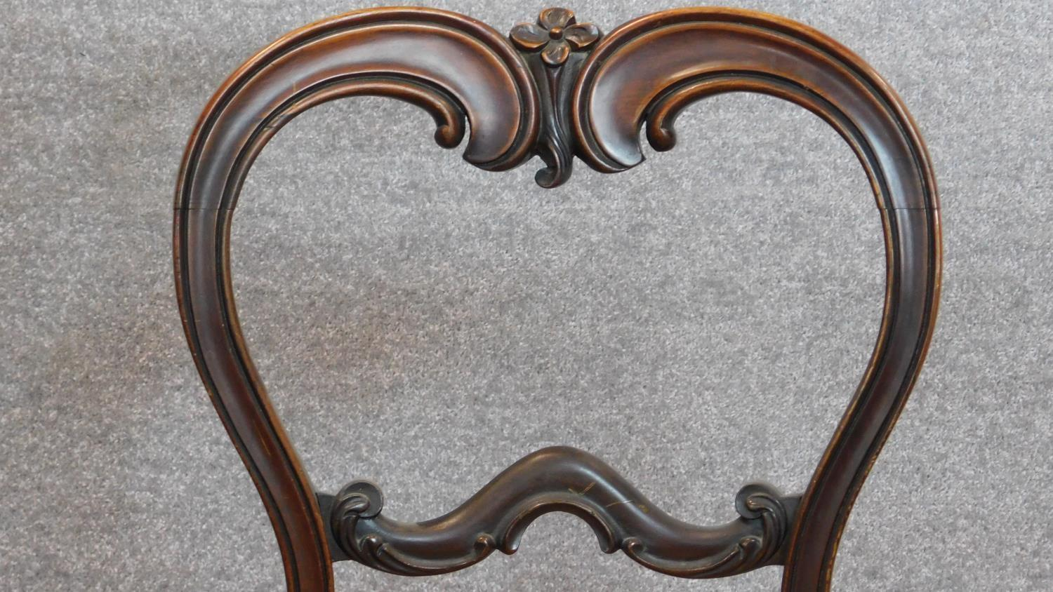 Lot 10 - A set of four Victorian rosewood balloon back dining chairs H.84cm