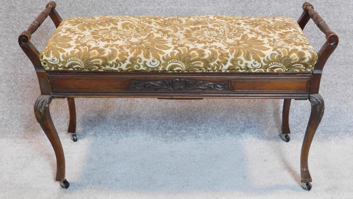 Lot 25 - A late Victorian duet stool on cabriole supports. 60x100x40cm