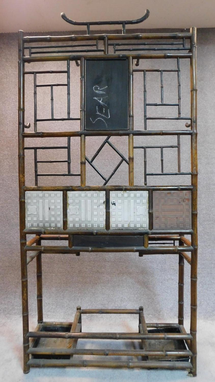 Lot 22 - A late Victorian aesthetic style bamboo hallstand with inset tiles. 198x96x30cm (mirror detached but
