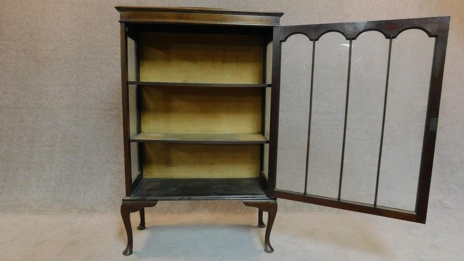 Lot 26 - An Edwardian mahogany display cabinet on cabriole supports. 127x77x24cm