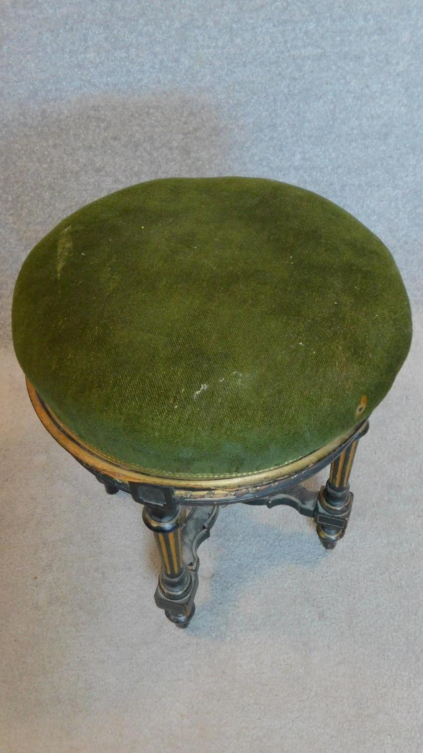 Lot 20 - A Victorian ebonised and gilt adjustable piano stool. H.48cm
