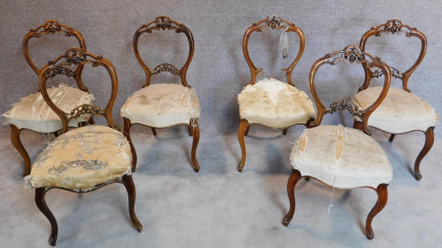Lot 9 - A set of six Victorian carved walnut balloon back dining chairs. H.89cm (one splat broken but