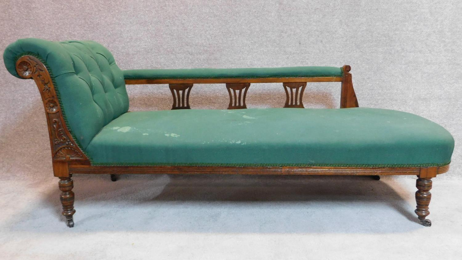 Lot 21 - A late Victorian walnut framed chaise longue in green upholstery on turned supports. 75x165x67cm